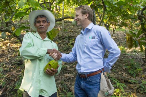 LWR President and CEO Daniel Speckhard meeting with cocoa farmer Don Cecilio Sosa.