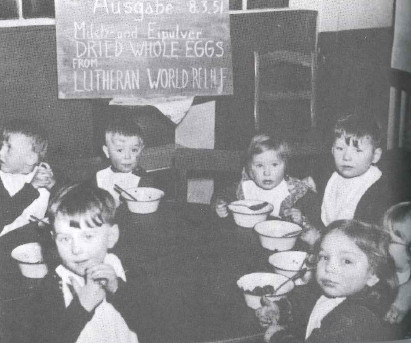 German children receiving food aid from LWR in 1951