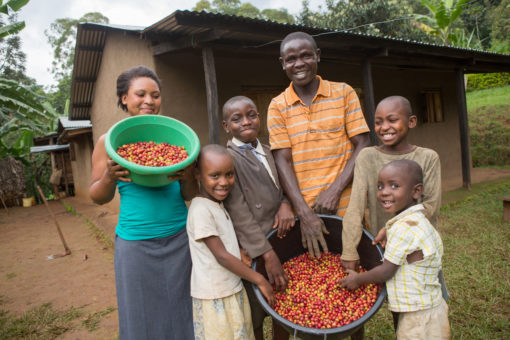 The Wotea family stands in front of their house in Uganda.
