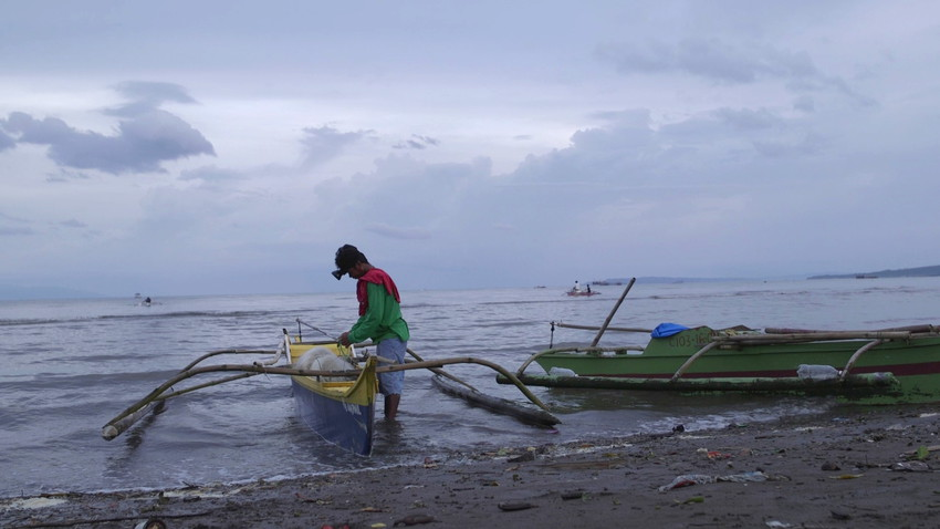 A fisherman prepares to go out in his boat three years after Typhoon Haiyan