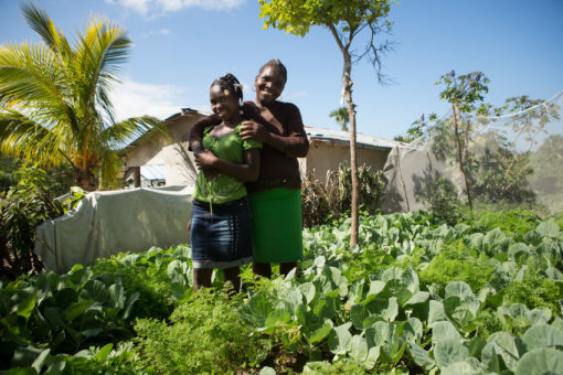 Etrenine Errilus, 50, poses for a portrait with daughter Delnise Derice, 18, in her home garden in the town of Falingant, in Haiti's Northeast province.